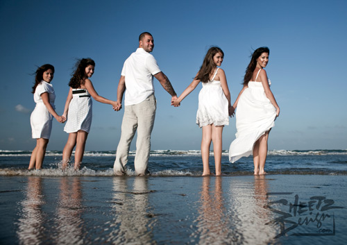 Family Holding Hands in the Surf
